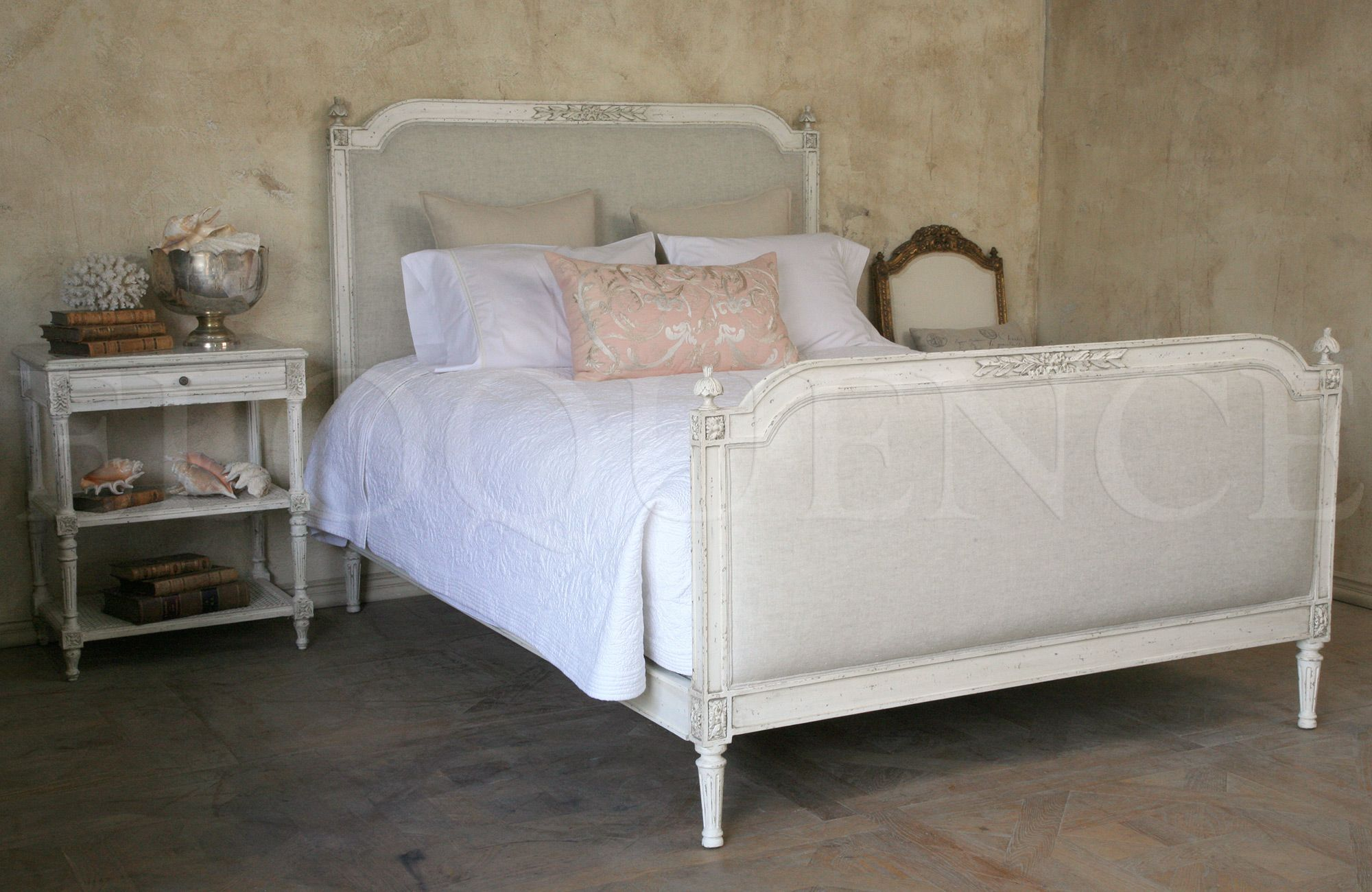 blanka bed available in king queen and twin sizes shown in antique white finish and fog linen blanka headboard